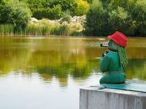 Duende de água verde com uma tubulação Foto de Stock Royalty Free