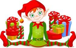 Duende de la Navidad con los regalos Foto de archivo libre de regalías