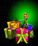 Duende de Santa com presentes Foto de Stock Royalty Free