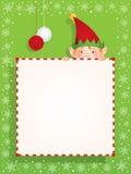 Duende do Natal atrás de uma bandeira vazia Imagem de Stock