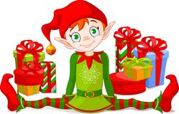 Duende do Natal com presentes Foto de Stock Royalty Free