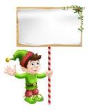 Duende do Natal com sinal Imagens de Stock Royalty Free