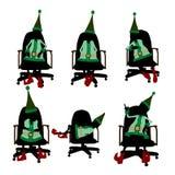 Duende do Natal que senta-se em uma silhueta da cadeira Foto de Stock