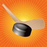 Duende malicioso de hockey y starburst de la naranja del palillo Foto de archivo libre de regalías