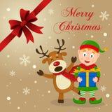 Duende y tarjeta de Navidad divertida del reno Foto de archivo