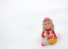 Duendecillo en la nieve Fotos de archivo