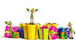 Duendes con los regalos de la Navidad Fotos de archivo