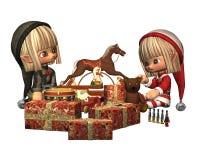 Duendes do Natal - envolvendo presentes Fotografia de Stock