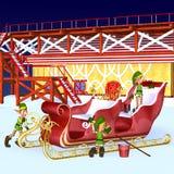 Duendes que detallan el trineo de Santa Imagen de archivo