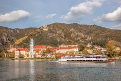 DUERNSTEIN CASTLE AND VILLAGE WITH BOAT ON DANUBE RIVER IN AUSTRIA Royalty Free Stock Images