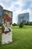 Duesseldorf City Gate and Part of Berliner Wall. Modern building City Gate in Duesseldorf and part of Berliner Wall with graffiti. It was a present to the Royalty Free Stock Images