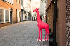 DUESSELDORF, GERMANY - FEBRUARY 13, 2017: With a red giraffe a retailer in the Altstadt increases visibility of his retail store.  Stock Photography