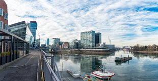 DUESSELDORF, GERMANY - JANUARY 20, 2017: After a cold night the water of the New Media Harbor is still coated with thin ice Royalty Free Stock Image