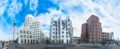DUESSELDORF, GERMANY - JANUARY 20, 2017: The famous Ghery-Buildings in the New Media Harbor shine against the vivid blue sky - Gra Royalty Free Stock Photography
