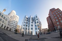 DUESSELDORF, GERMANY - JANUARY 22, 2017: The famousGhery-Buildings in the New Media Harbor shine in the evening sun - Fish Eye Stock Photo