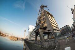 DUESSELDORF, GERMANY - JANUARY 20, 2017: Fisheye view on the pier in the new Media Harbor and an old crane Royalty Free Stock Photography