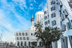 DUESSELDORF, GERMANY - JANUARY 20, 2017: The Gehry buildings in the New Media Harbor build a new Landmark together with the TV Tow Royalty Free Stock Images