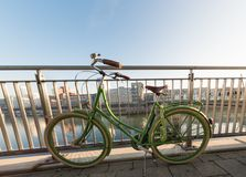 DUESSELDORF, GERMANY - JANUARY 20, 2017: A green bycicle is leaning on the handrail in the New Media Harbor Stock Photography