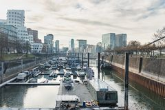 DUESSELDORF, GERMANY - JANUARY 20, 2017: The marina on the other side of the New Media Harbor hosts private and commercial vessels Stock Photography