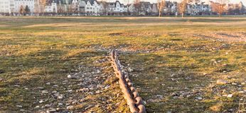 DUESSELDORF, GERMANY - JANUARY 20, 2017: An old anchor chain provides testimonial for ancient transportation services on river Rhi Royalty Free Stock Photo