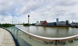 DUESSELDORF, GERMANY - JUNE 29, 2016: Panorama view on TV-Tower, marina and famous buildings at new media harbor of Stock Images
