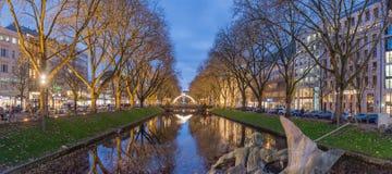 DUESSELDORF, GERMANY - NOVEMBER 28, 2017: Scenic Blue Hour Panorama of famous Koenigsallee. DUESSELDORF, GERMANY - NOVEMBER 28, 2017: Scenic Blue Hour Panorama royalty free stock photography
