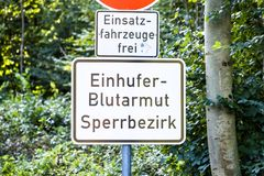 Duesseldorf , Germany - October 05 2017: Sign warning of of the infectious equine anaemia EIA . Translation: Equine Stock Photography