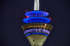 DUESSELDORF, GERMANY - SEPTEMBER 14, 2016: The TV tower is illuiminated with blue light during night hours. DUESSELDORF, GERMANY - SEPTEMBER 14, 2016: The TV Royalty Free Stock Photo
