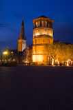 Duesseldorf old town at night. Duesseldorf navigation museum called Schlossturm part of the old city at night Royalty Free Stock Image