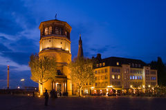 Duesseldorf old town at night. Duesseldorf navigation museum called Schlossturm part of the old city at night Stock Photos