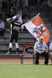 Duesseldorf Panther v Dresden Monarchs,. Panther #20 Boris Marschall greets the crowd and fires them up, with the Düsseldorf city flag  before the game. August Royalty Free Stock Photo