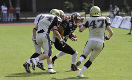Duesseldorf Panther v Dresden Monarchs,. Panther #21 wide receiver Estrus Crayton of the USA,gets into trouble. There are 6 US players on the Panther roster Royalty Free Stock Photo