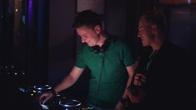 Duet of Dj and man with saxophone perform on party in nightclub. Musicians. stock video