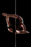 Duet of flexible young pole dancers Royalty Free Stock Photos