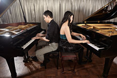 Duet with pianos Stock Image