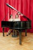 Duet on a single piano Stock Photo