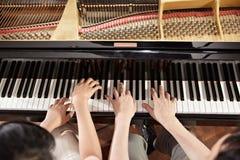 Dueto do piano imagens de stock royalty free