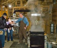 Duff`s Sugar House making Maple Syrup. Monterey, VA – March 16th: Boiling map sap into maple syrup Duff`s Sugar House located in Blue Grass Valley stock photo