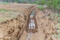 Dug in the ground a big trench. Horizontaln royalty free stock photos