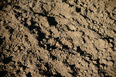 Dug ground. The close up of dug and loosened soil royalty free stock image