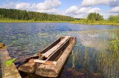 Dug-out in small forest lake Stock Images