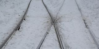 Dug in the snow rails. A dug in the snow rails stock image