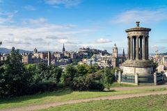 Dugald Stewart monument on Calton Hill with a view on Edinburgh. Scotland Stock Images