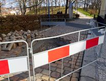 Dugged walkway and hole in the pavement. The protection block. Park with trees royalty free stock photos