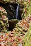 Small waterfall in a narrow rocky gorge in the North Carolina mountains in autumn royalty free stock image