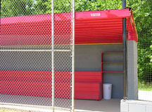 The dugout. A bright red dugout at a baseball field Royalty Free Stock Photo