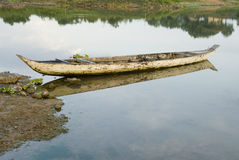 Dugout canoe. On a tributary to the Mekong royalty free stock images
