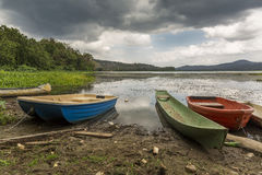 Dugout Canoe and Other Boats at River's Edge - Gamboa, Panama Royalty Free Stock Image