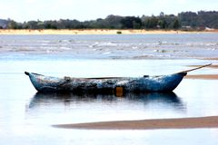 Dugout canoe in the shallow water Royalty Free Stock Photography