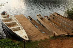 Dugout Canoes waiting at the Dock Stock Photos